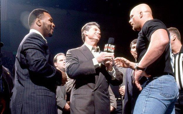 (1/19/98) On This Day 2️⃣3️⃣ years ago, #StoneColdSteveAustin confronted #MikeTyson on RAW! 🎈😱