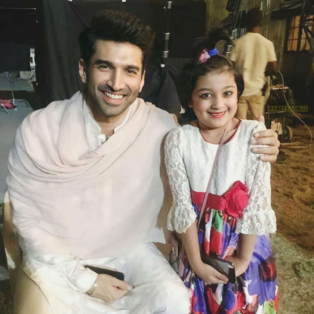 #Repost @filmfare An adorable picture of#AdityaRoyKapurwith a little fan from the sets of#Kalank. #throwback