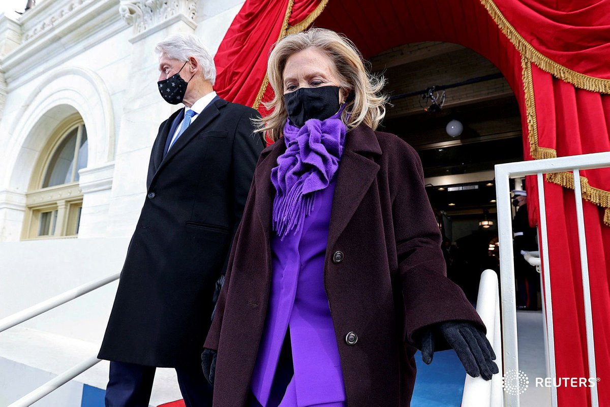"""Former President Bill Clinton and his wife  Hillary Clinton arrive before the inauguration of Joe Biden as the 46th  President of the United States on the West Front of"