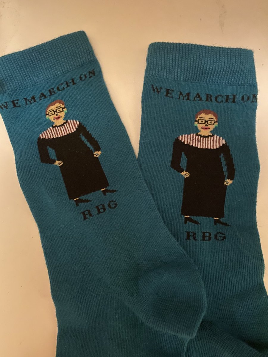 In honor of today I'm wearing my RBG socks and earrings, my grandmother's pearls and a mask that says a great message. And yes, I'm wearing blue  #inaugurationday 🎉🌊