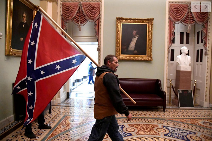 .@laurenboebert Kevin Seefried, who was photographed holding the Confederate flag inside the Capitol on January 6, was arrested Thursday in Delaware, according to the New York Times. The FBI had issued a poster asking the public to help identify him. https://t.co/YbGa8kZH3v