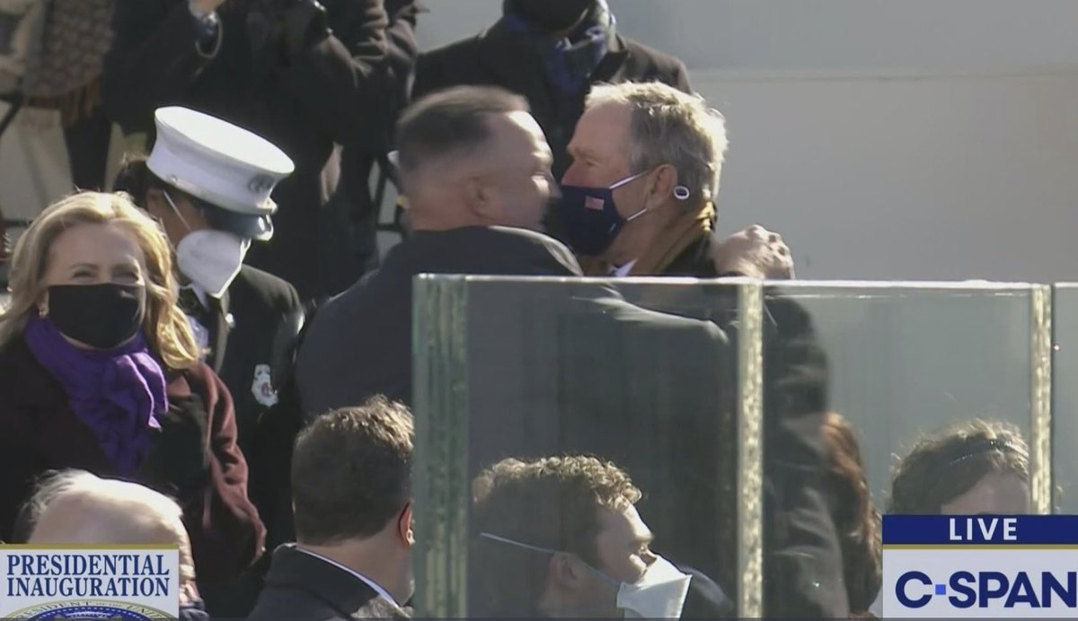 Garth Brooks and George W Bush lip-kissing was definitely the most unexpected moment of the inauguration. It's still technically a Lip Kiss if one participant is wearing a mask, GWB, we all know that trick.