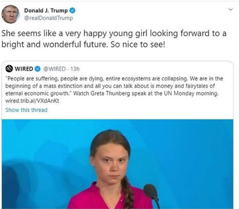 Greta Thunberg waiting in the tall grass for as long as it takes.