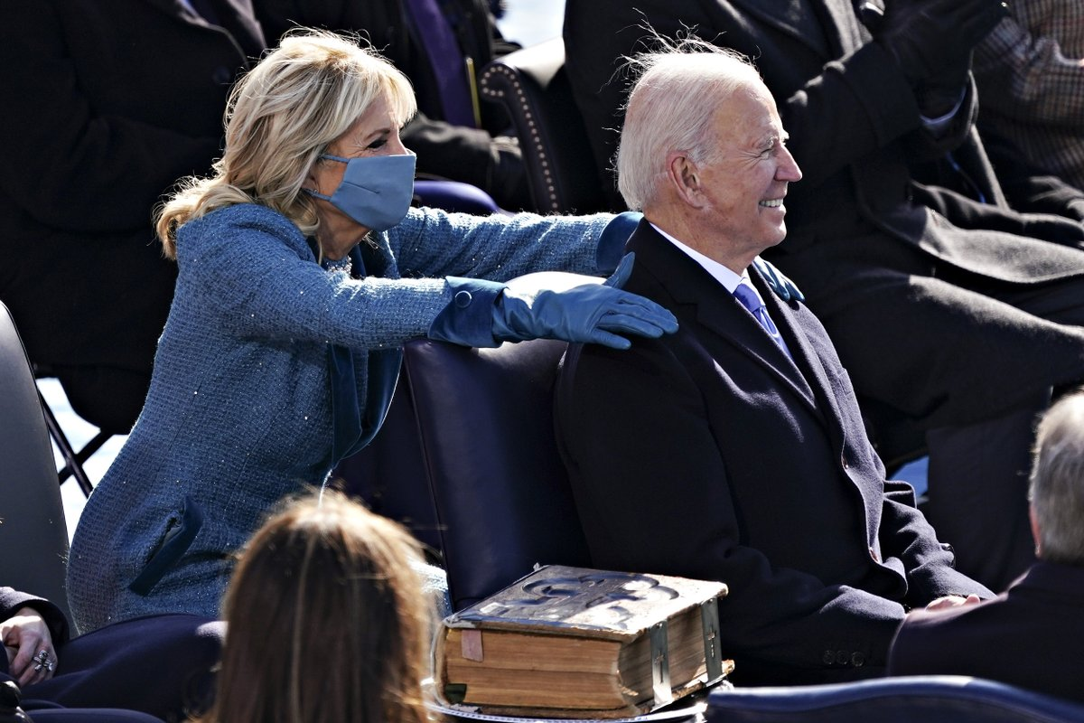 First lady Dr. Jill Biden places her hands on the shoulders of President Biden at Inauguration.  📷 Kevin Dietsch / Getty