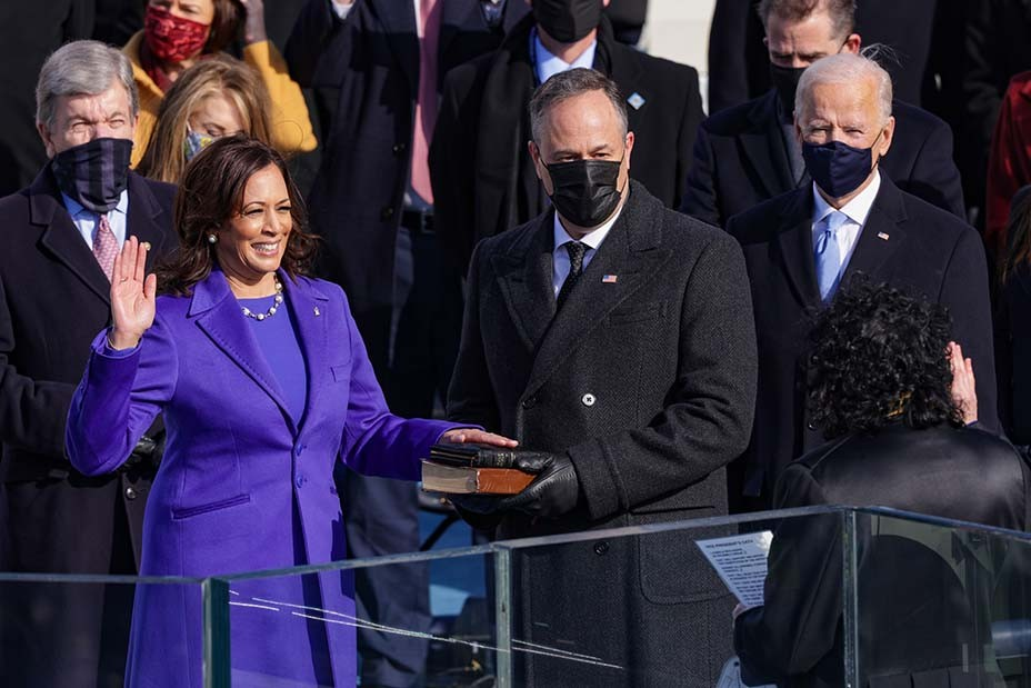 Vice President Kamala Harris worked with New York-based Christopher John Rogers on an ensemble in purple, which she accented with her signature pearls and an American flag pin produced by David Yurman