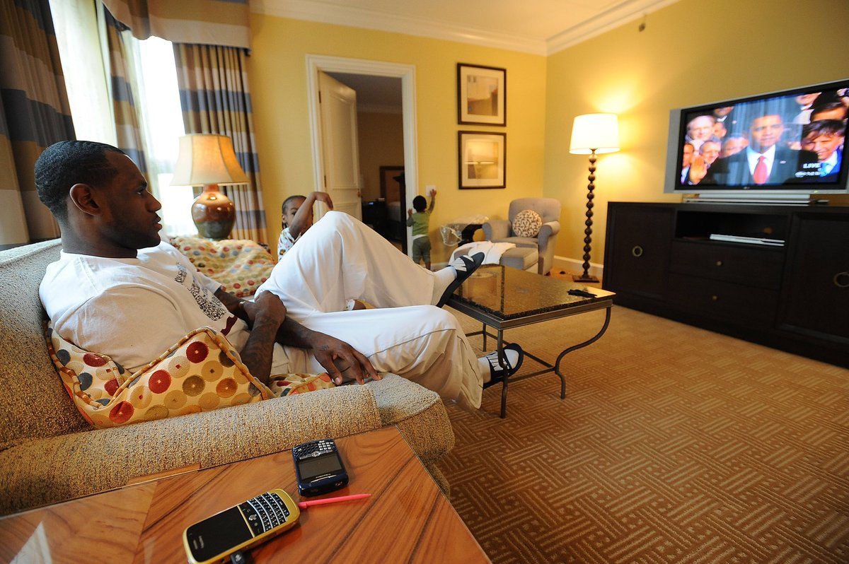 LeBron watching President Obama's inauguration with Bryce & Bronny on this date in 2009.  Blackberry phones on the table. Bronny playing Nintendo DS.  What a time. (📸: @ADBPhotoInc)