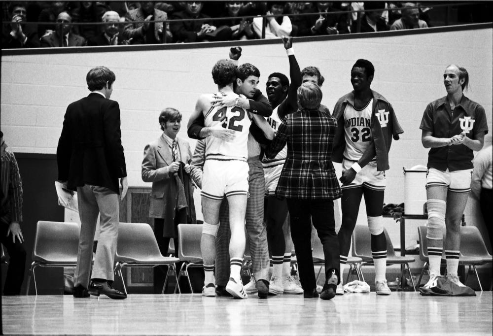 Coach Bob Knight embraces John Ritter as fellow Hoosiers Quinn Buckner, Steve Downing, and Don Noort celebrate during Indiana's 83-71 upset win over #6 Minnesota, January 20, 1973. Senior John Ritter leads IU with 22 points with John Laskowski adding in 17 pts. #iubb @IndianaMBB