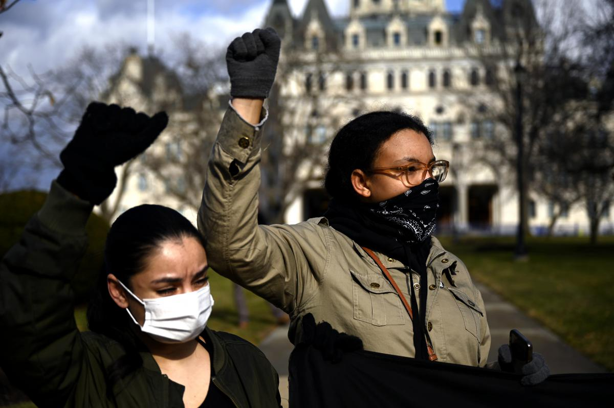 As dignitaries filed into their seats for President Joe Biden's inauguration in Washington, D.C., roughly a dozen people affiliated with the Black Lives Matter movement in Connecticut marched to the front of the state Capitol in Hartford. /1