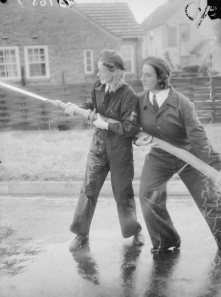#OTD in 1943 Two members of the Women's Royal Australian Naval Service (WRANS) Fire squad carry out a drill #OnThisDay in Melbourne, VIC. 137657 #myAWM #AWMemorial