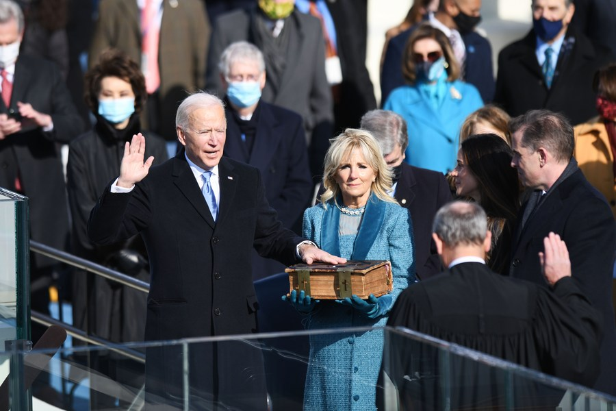"""""""To overcome these challenges, to restore the soul and secure the future of America requires so much more than words and requires the most elusive of all things in a democracy: unity,"""" said Biden in his inauguration speech Read Xinhua Headlines for more:"""