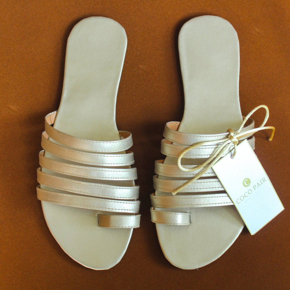 NEW NEW NEW!!  Say hi to our just addded coco pair.   / Coco Light Gold strappies / . We're pretty sure, you would love to see this in your wardrobe. Also, wanna customize? Drop us a DM. :)  #cocopair #footwear #sandals #slippers #handmadewithlove #lightgoldslippers