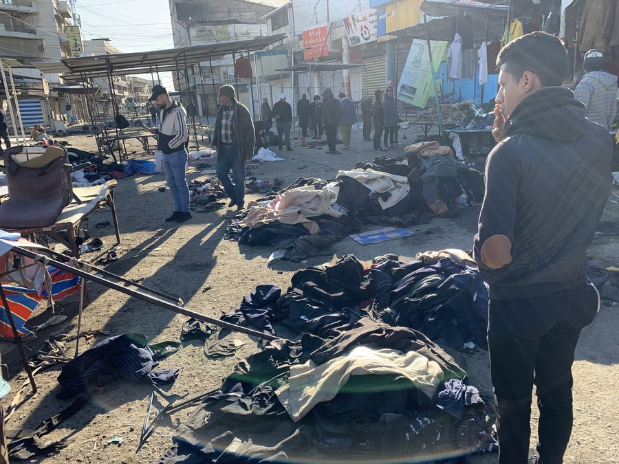 Twin suicide bombings ripped through a busy market in the Iraqi capital Baghdad Thursday, killing at least 32 people and wounding 110 others
