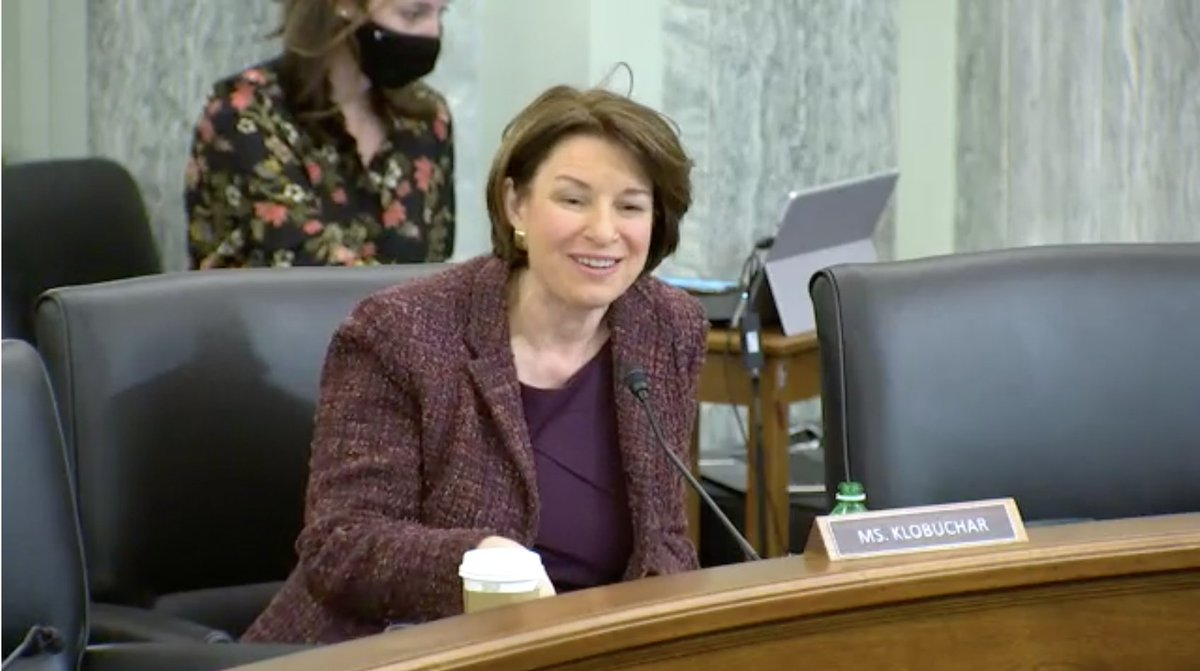 "Amy Klobuchar, who sits on the Senate Commerce Committee, greets her old campaign rival, Pete Buttigieg, says, ""I think you know I'm excited about your nomination....I know you well, and I can attest to my colleagues what a forward thinking and thoughtful secretary you will be."""