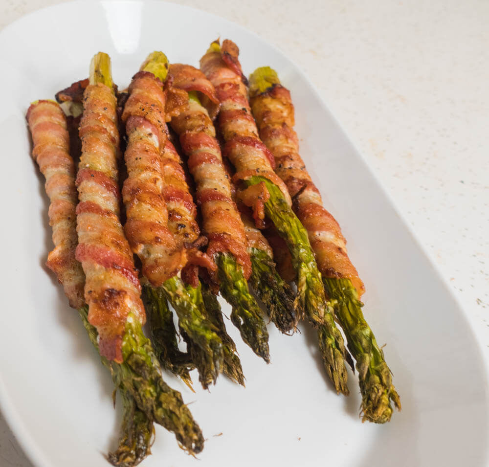 This is a tasty side that I have been making lately. It goes with just about anything and is easy to make. Sharing. Bacon Wrapped Asparagus (Air Fryer)  #bacon #asparagus #airfryer #sidedish #stuffmattycooks  Recipe Here: