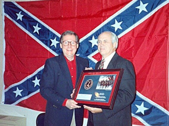 """Now that Mitch McConnell (pictured here with his favorite racist flag) is finally out of power he is demanding a """"shared power agreement"""" with Democrats.  It's absurd.  I pray to God that @SenSchumer just say NO."""