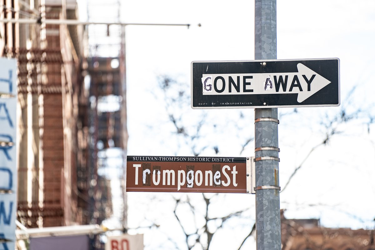 "A street sign reading ""Thompson St"" was painted over to read ""Trumpgone St"" and a ""One Way"" sign was changed to read ""Gone Away"" on Thursday in #NewYorkCity, reflecting the end of the tenure of #DonaldTrump as the 45th president of the United States."