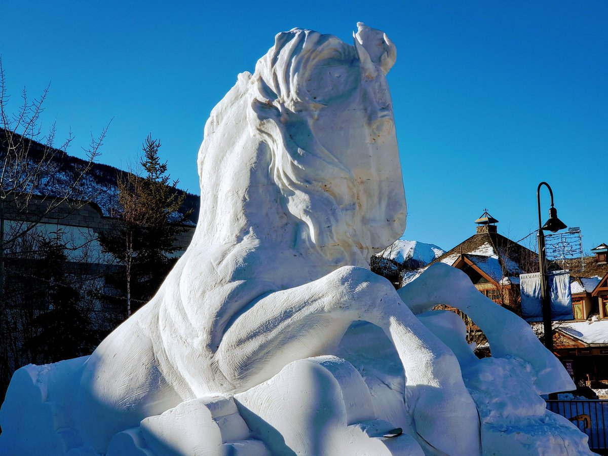 Gigantic #snow sculptures have started popping out in the streets of #Banff #Alberta #Canada #banffsnowdays #snowart