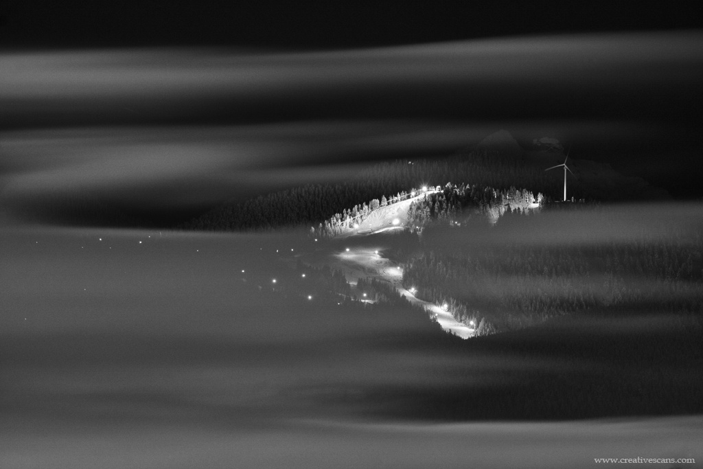 The lights of Grouse Mountain shine through layers of cloud. Prints available. . . . . #explorebc #photos604 #blackandwhite #beautifulbc #pacificnorthwest #life_in_canada #outdoors #shareyourweather #mountains #snow #fog #myportcity #decor #homedecor @grousemountain