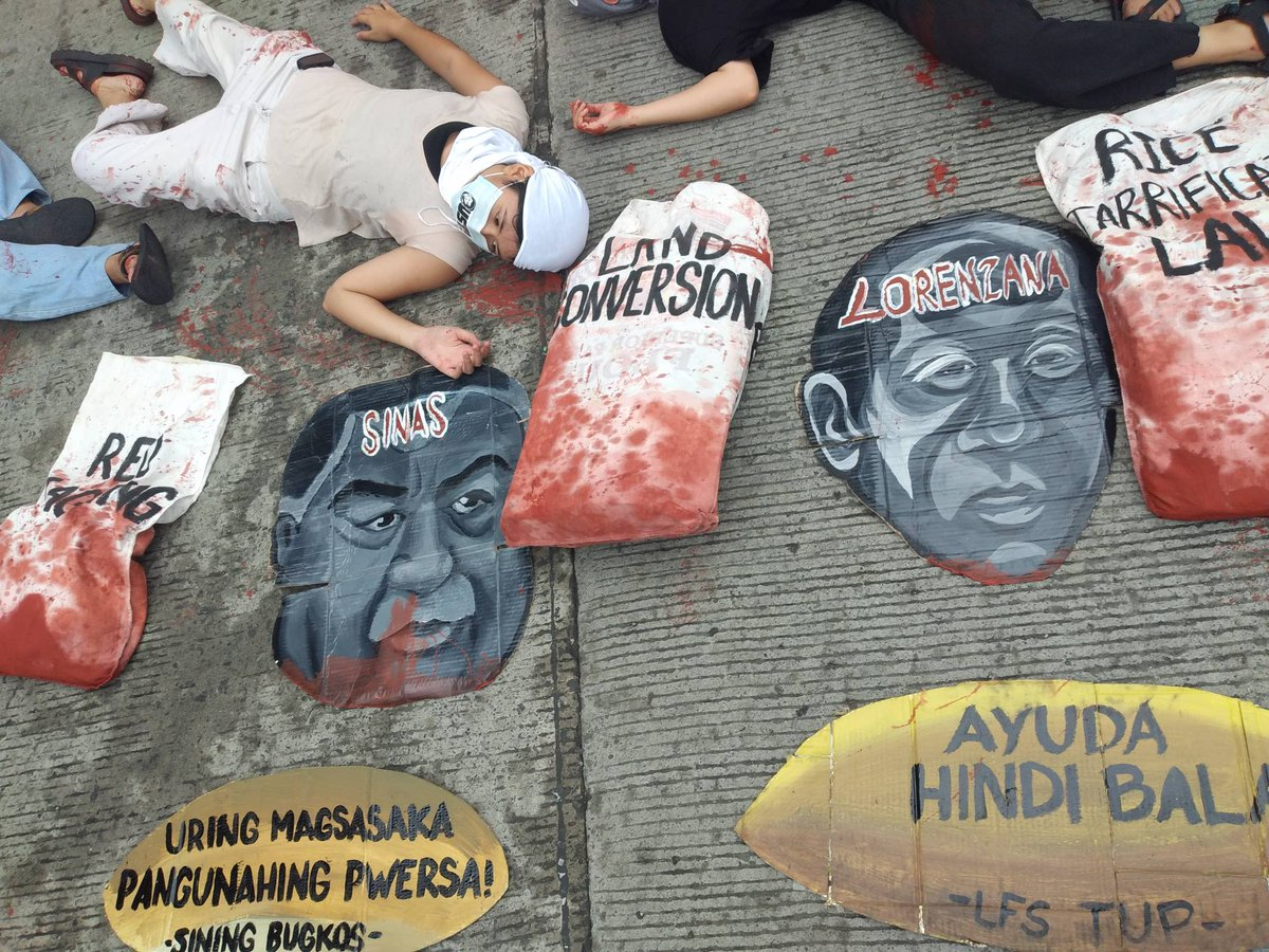 Members of UgatLahi stage a die-in protest to symbolize their call for an end to land grabbing, killing of farmers.