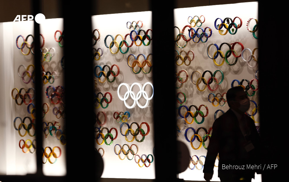"""Japan's prime minister says he is """"determined"""" to hold the Tokyo Olympics - bushes off London Times report claiming officials think cancellation is inevitable"""