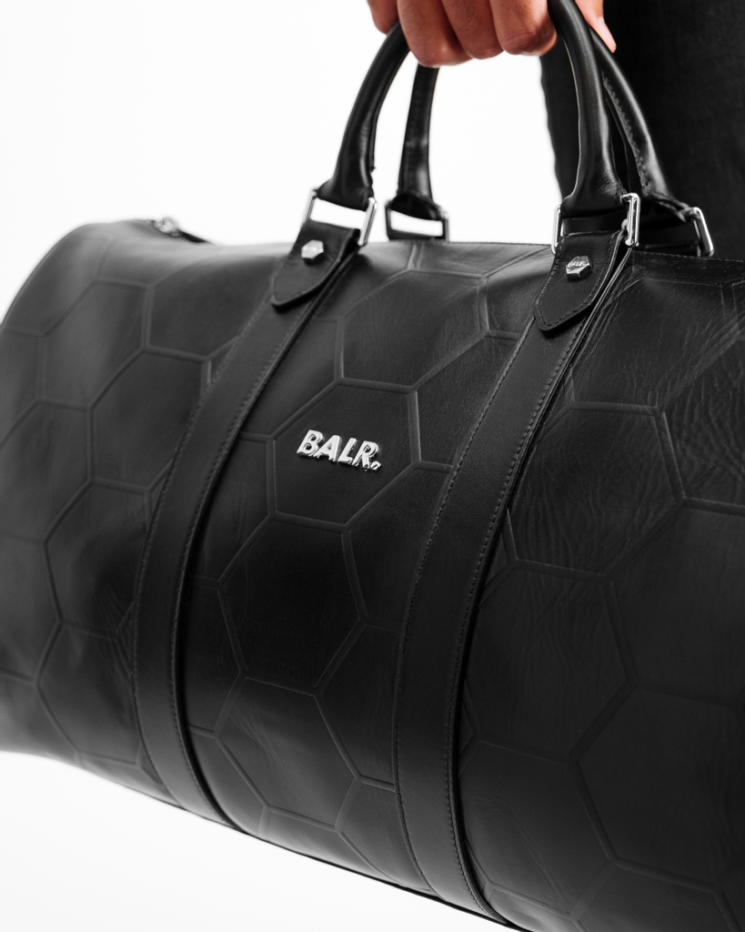 Go in style or go home. This Hexagon Embossed Leather Duffle Bag is your go-to piece, since it's both stylish and functional. 🏆   #BALR #Menswear #Womenswear #LIFEOFABALR. #Lifestyle #Amsterdam