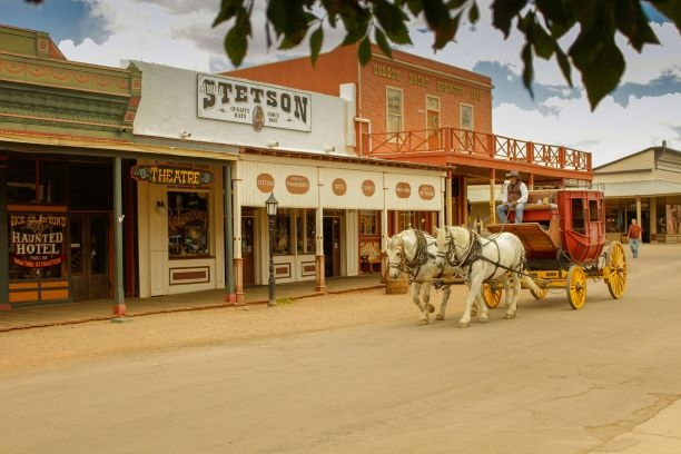 """Go back in time to the wild west in Tombstone. Founded in 1877, it is one of the most well-preserved """"boomtowns"""" in the United States, with the discovery of silver and gold in the mid-1800s. #tombstonearizona #wildwest #visitarizona #history #miningtown #cowboys #travelwest"""