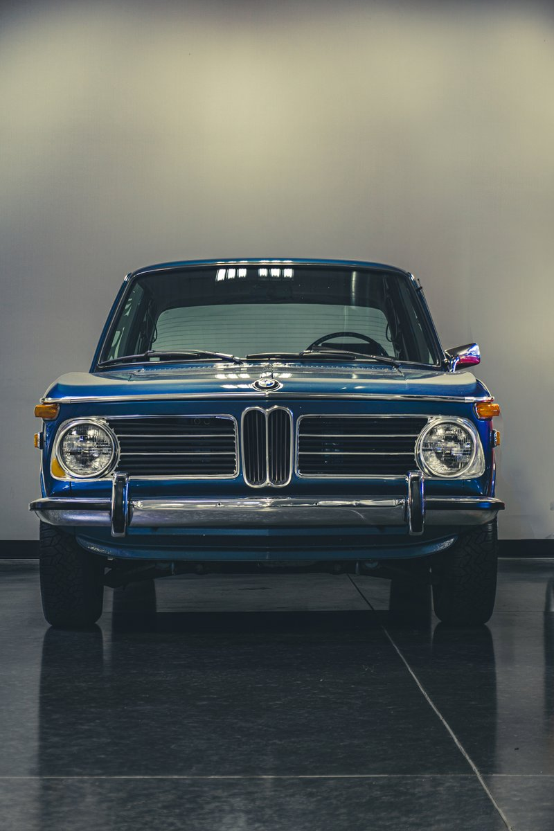 Some serious old-school cool! 💙 #BMW #2002tii #FlashbackFriday #BMW2002 #ClassicCars