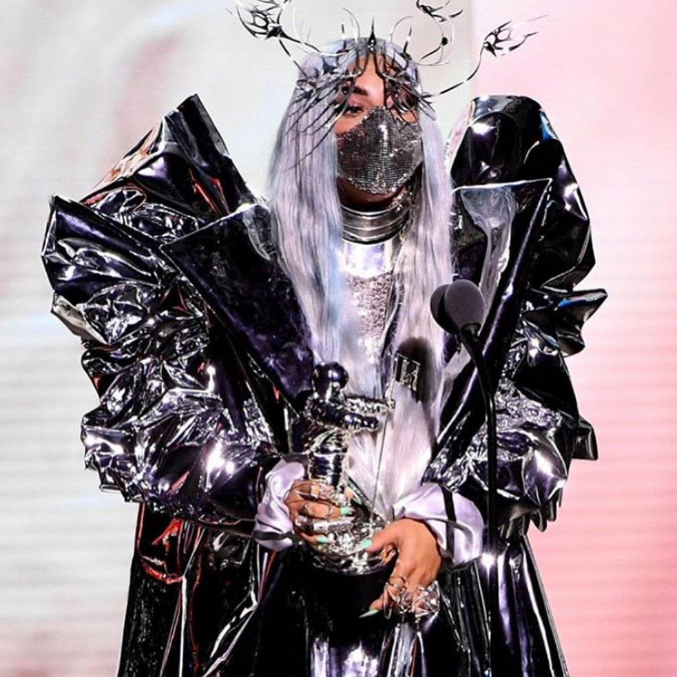 """""""Her VMA outfits will go down in history as the first social distancing couture.""""-Vogue 2020  """"She wore a custom Schiaparelli Couture ball gown with a gold dove pin and an ornamental beauty look that will go down in history.""""-Vogue 2021  Lady Gaga, Queen of Going Down in History!"""