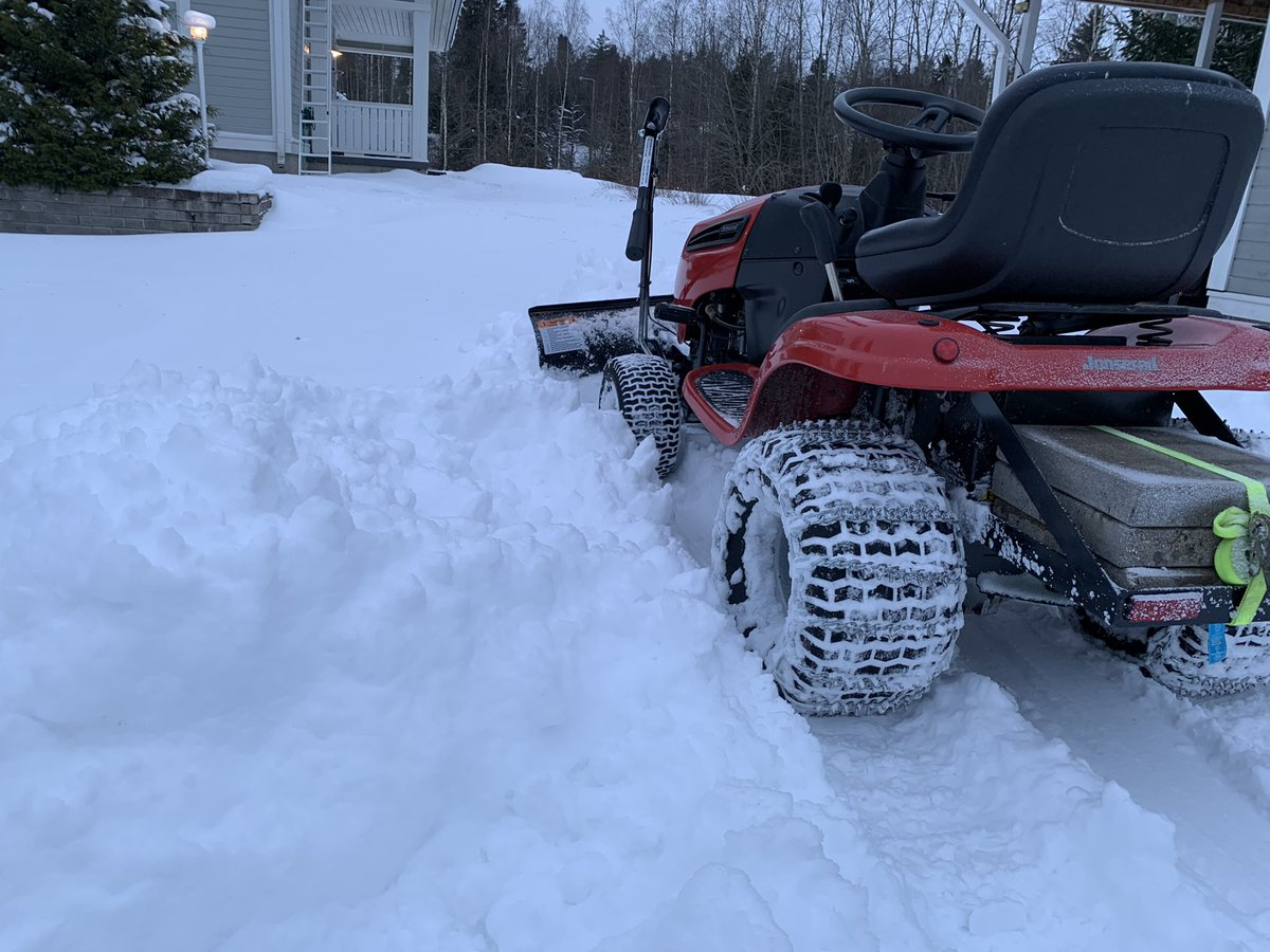 The only day when snow blower would make more sense. My tiny snow plow is just too small and gets stuck. It took almost 3 hours to clear the driveway.   #snow #snowplow #lawntractor #winter #jonsered
