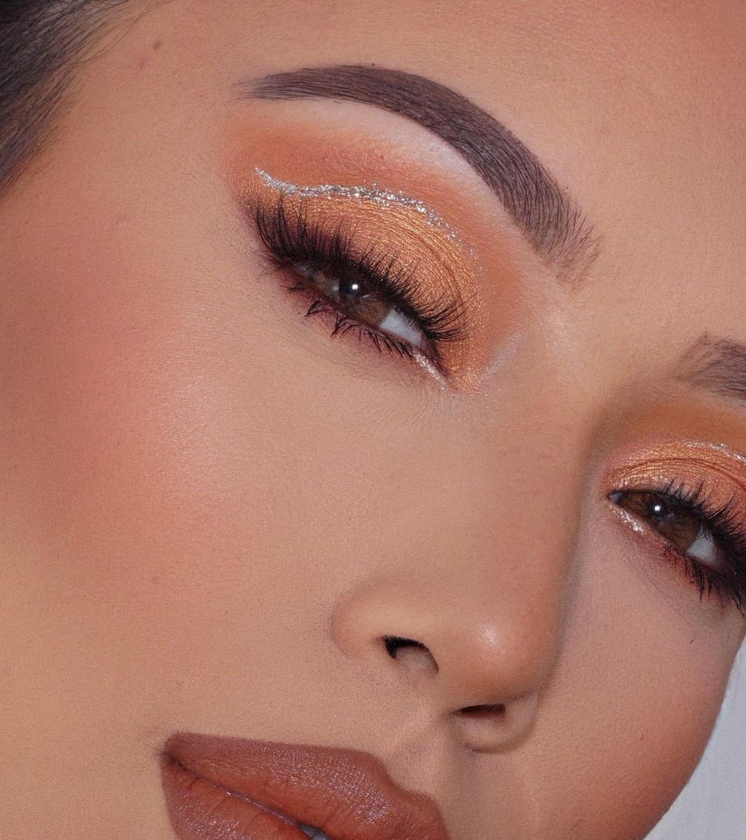 .@priscilla_fhern wearing tanned and gorgeous bronzer to complete this gorgeous peachy makeup look! 🤎✨