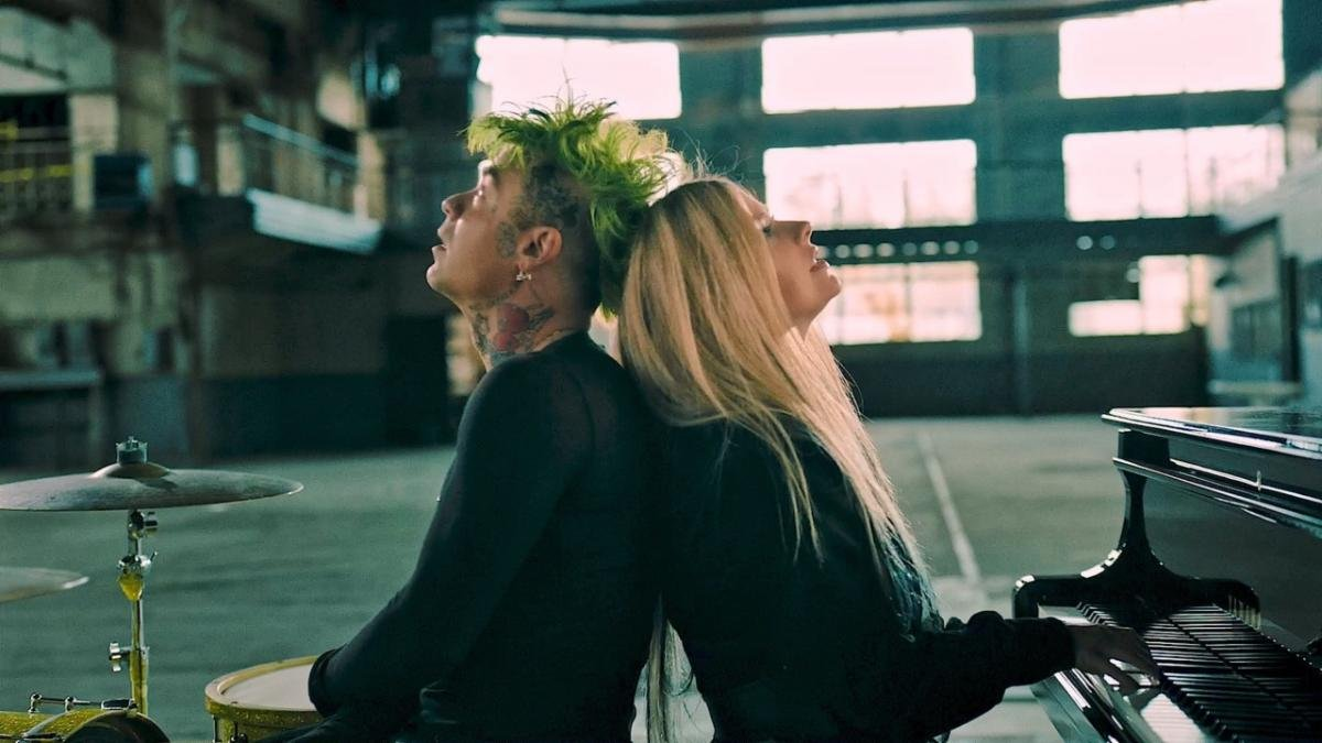 """Check It Out: Watch @MODSUN and @AvrilLavigne's explosive new video for """"Flames"""""""