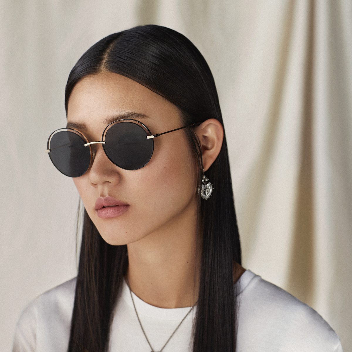 The #DolceGabbana sunglasses include round lenses and thin, gold metal frames.  Discover the #DGEyewear at the link: