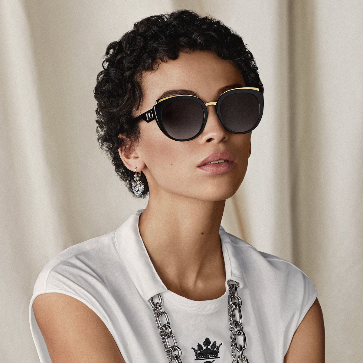 The #DolceGabbana sunglasses include gold metal details on a black acetate frame.  Discover the #DGEyewear at the link: