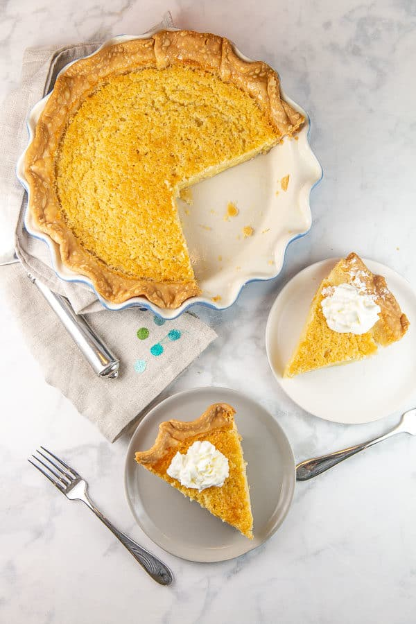 Why decide between an after dinner drink or a slice of pie when you can have both with this easy peasy Bourbon Buttermilk Pie? Don't forget the dollop of bourbon whipped cream on top! #baking #pie #thanksgiving