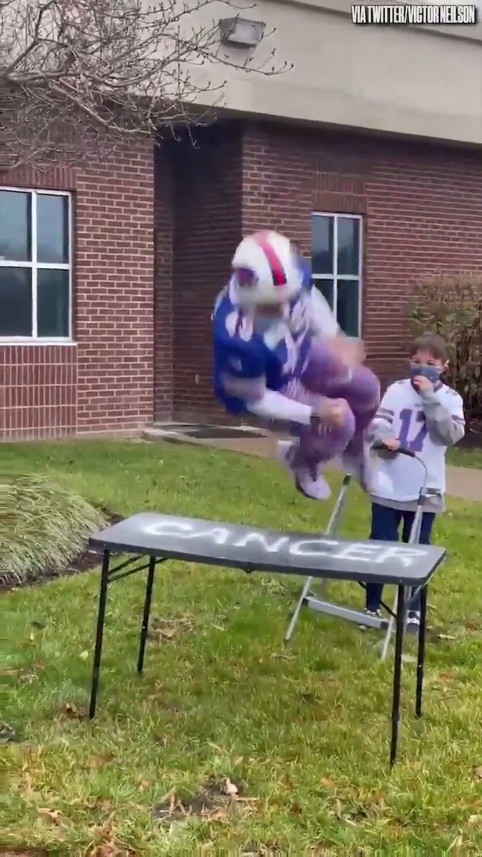 This @BuffaloBills fan (@neilsonvic) celebrated beating cancer in the most #BillsMafia way possible.  Destroying a folding table.