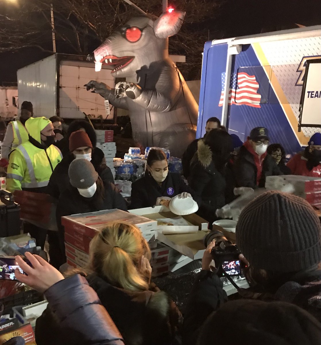 Replying to @sicknerpe: Oh hey it's @AOC serving pizza in front of Scabby!
