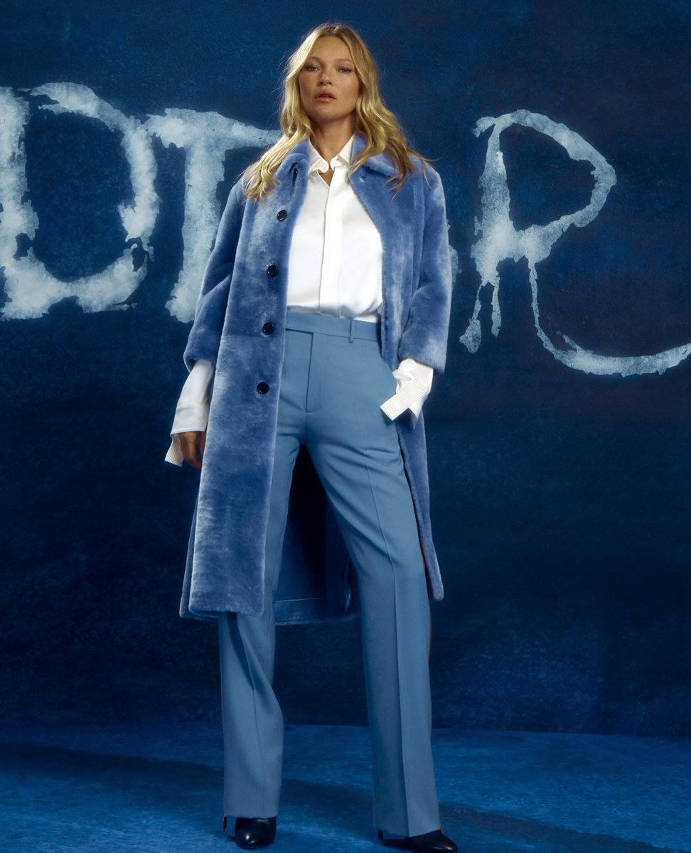 In statement pieces including a shearling coat and 'Dior and Peter Doig' jumpsuit, respectively, Kate Moss and Lila Grace Moss were among the House friends to watch yesterday's unveiling  of #DiorWinter21 by Kim Jones in collaboration with Peter Doig.