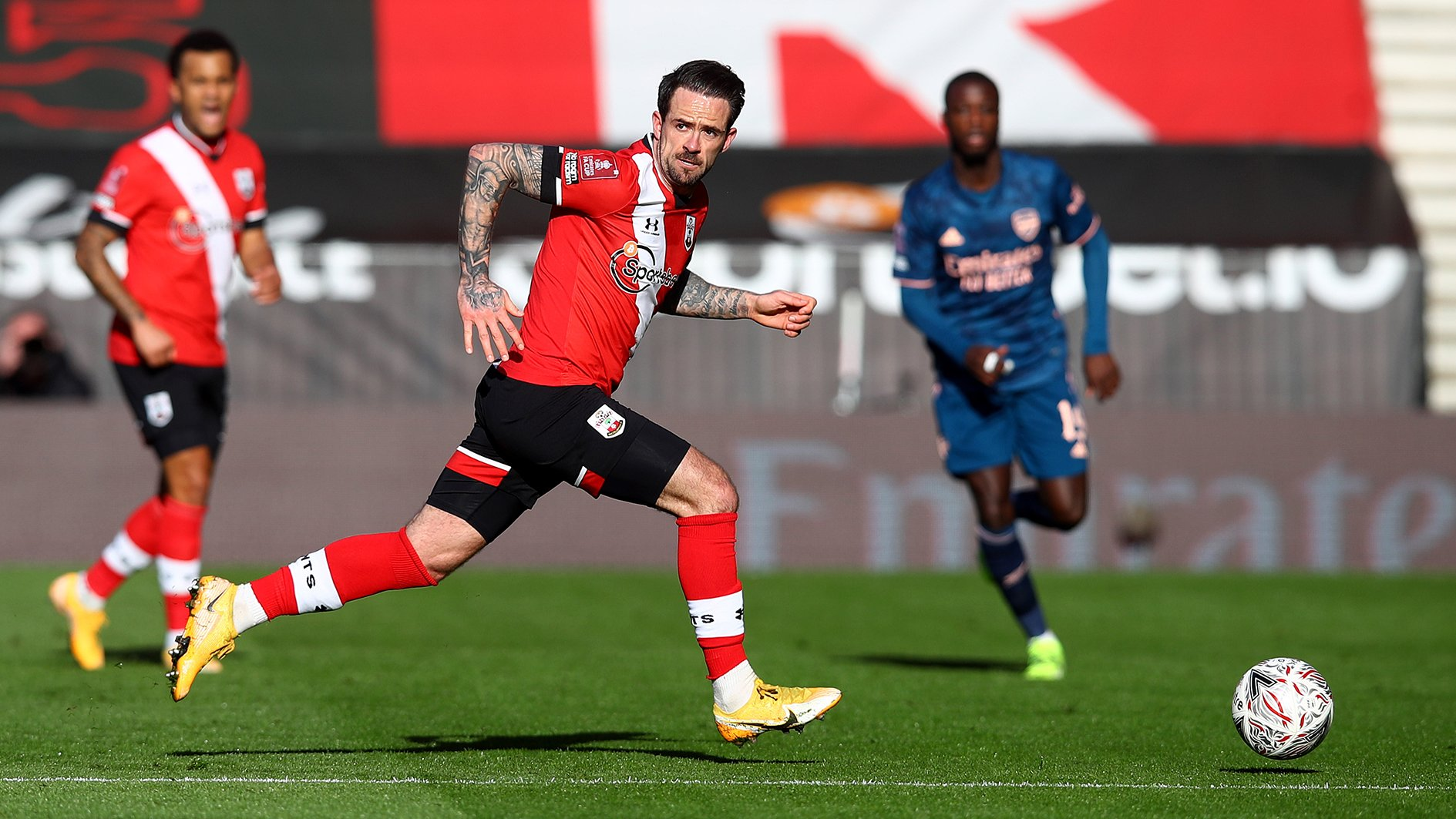 Danny Ings runs with the ball.