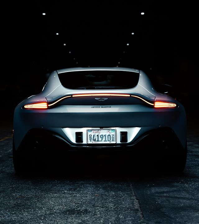 The signature ultra-slim rear light graphic illuminates the full-width of the tailgate, accentuated by the flick in the Vantage's tail.   Enquire now. For more details call us.  ☎️ Sales: +(968) 2459 6434  #AstonMartin #Vantage #AstonMartinVantage #BeautifulWontBeTamed