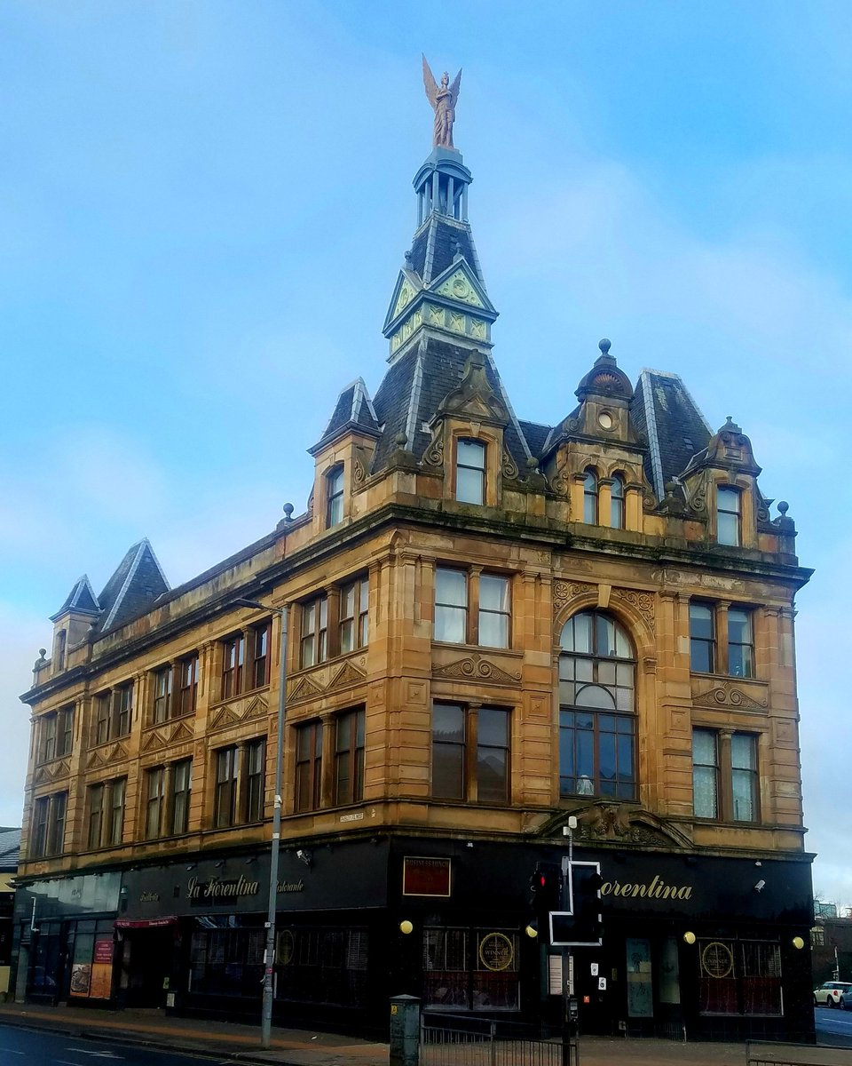 The Angel Building, Paisley Road West, Glasgow.  Built in 1889, this building originaly served as home to Ogg Brothers department store. As a result, the angel on the top is nicknamed Mrs Ogg.  #glasgow #buildings #design #architecture #architecturephotography #angels #mrsogg