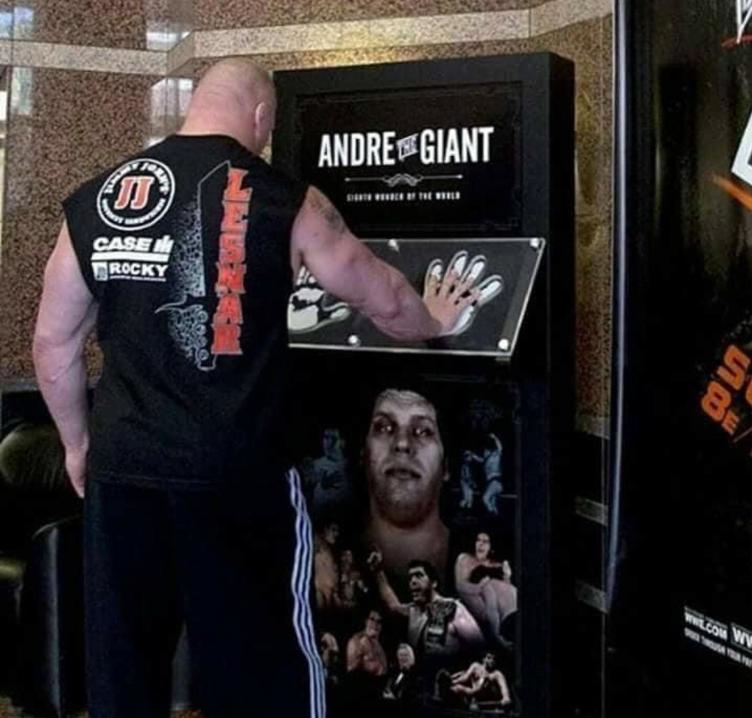 Replying to @90sWWE: Awesome pic of Brock Lesnar comparing his hand size to Andre The Giants 🖐🏻