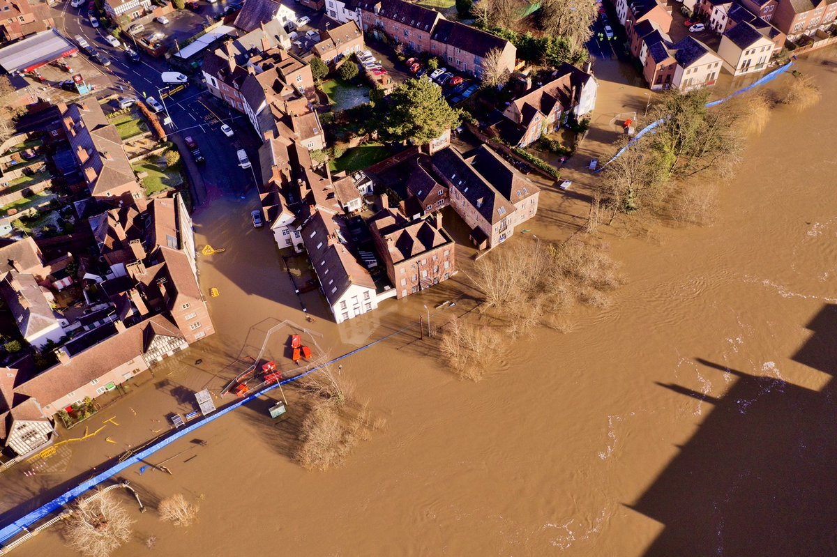 Aerial photos from @DaveThroupEA show the extent of the flooding in Bewdley as the River Severn peaks this afternoon.  See more photos from flooding across the region here 👇  https://t.co/cG98mu0QMT https://t.co/sEyS9I2Pvm