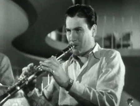 """Today in #WWII History: 80 Years Ago—Jan. 23, 1941: Artie Shaw records """"Dancing in the Dark"""" and """"Moonglow."""" [Photo: Artie Shaw playing """"Concerto for Clarinet"""" in """"Second Chorus,"""" 1940] #TDIH #OTD"""