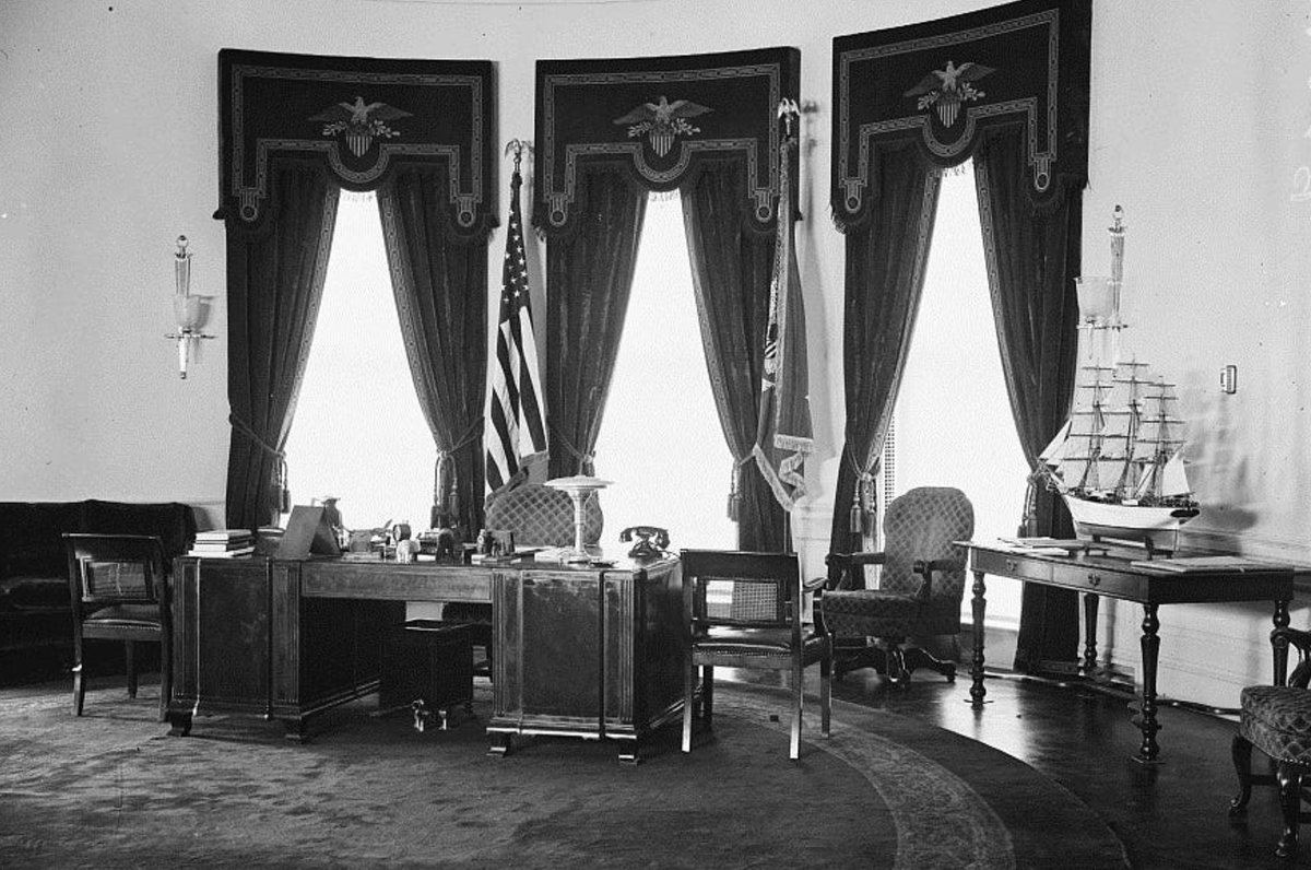 FDR and his large ship model move into newly-built Oval Office, 1934: