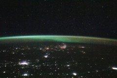 iss064e023203 (Jan. 13, 2021) --- This view from the International Space Station, as it orbited 264 miles above Kazakhstan, looks north towards Russia with its brightly lit cities blanketed by an aurora.