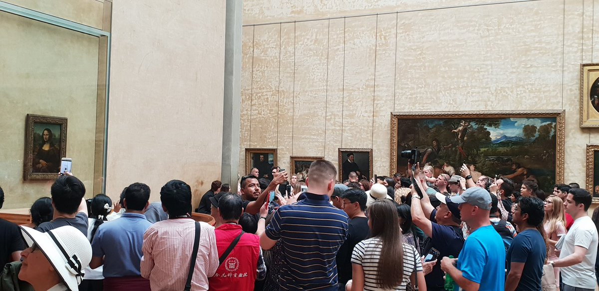 Remembering that time when I got close enough to see the Mona Lisa through someone else's phone screen! Well worth the queuing up 😂 #MonaLisa #louvre