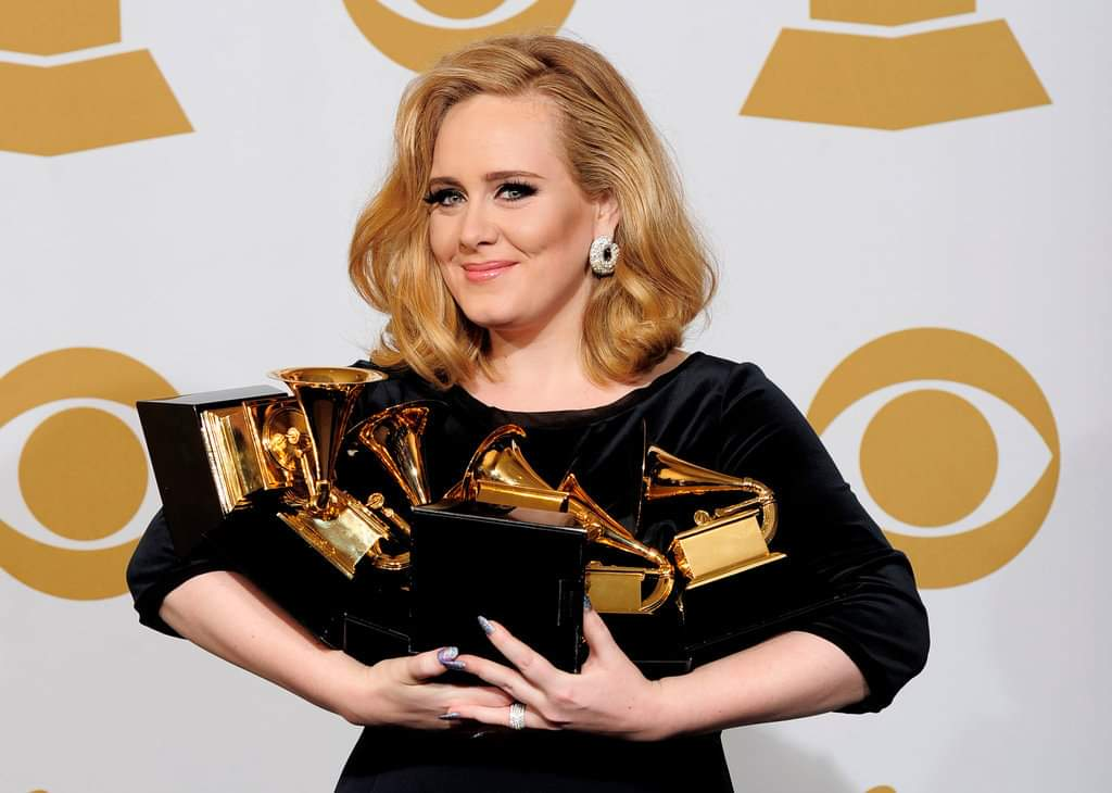 Adele has the 2nd most awarded album by a female artist on #GRAMMYs. The singer also holds the record for most GRAMMYs won in a single night.  • Album of the year • Record of the year • Song of the year • 2x Best pop solo perfom. • Best pop vocal album • Best Short MV