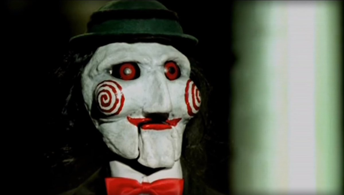 just learned that in the original saw short film, billy the puppet had a little hat and i'm fucking losing it