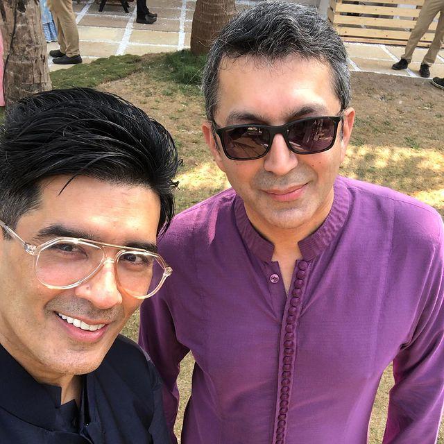 #ManishMalhotra and #KunalKohli pose for a selfie during #VarunDhawan and #NatashaDalal's wedding festivities.