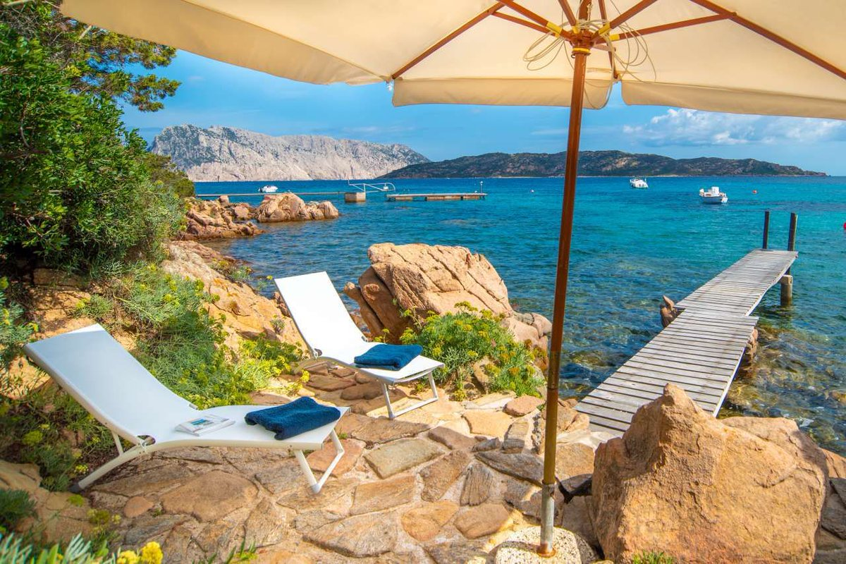 Another Beach Front Sardinian Gem!    Glamorous villa, with clean white interiors.  A short path leads to the private jetty.  Dock your yacht here and live the good life.    #Sardinias #PrivateJetty #ThursdayMotivation  #Waterfront #ThursdayThoughts